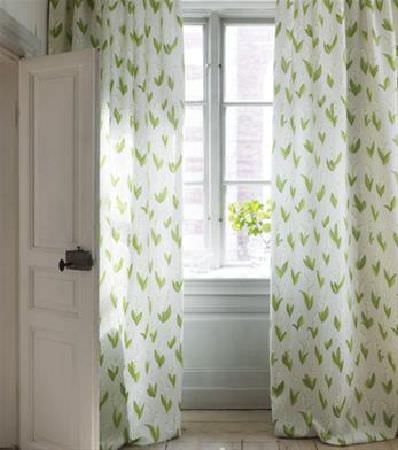 Sandberg -  Elin Fabric Collection - A design of green leaves printed on white, floor-length curtains