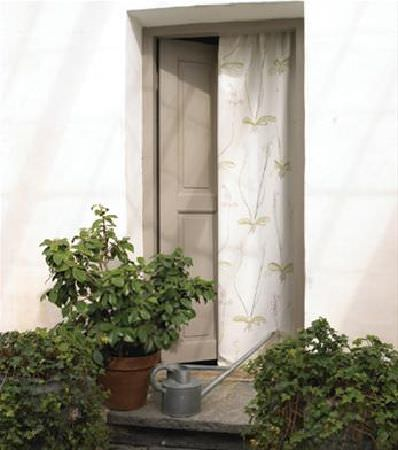 Sandberg -  Elin Fabric Collection - Large terracotta flower pots, with silver watering can with long nozzle, in front of white curtains with a large but subtle green leaf print