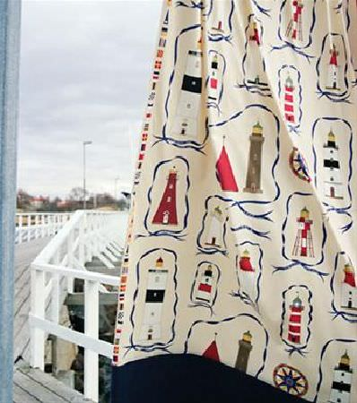 Sandberg -  Elin Fabric Collection - Nautical themed lighthouse print fabric (with the main colours of cream, blue and red), with a navy blue trim at the bottom