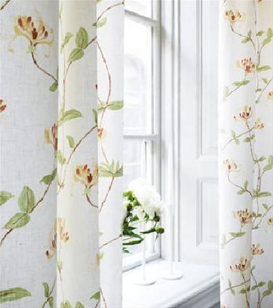 Sandberg -  Elin Fabric Collection - A simple design of red and yellow flowers, thin brown branches and realistic green leaves, printed on bright white curtains