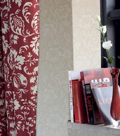 Sandberg -  Elin Fabric Collection - Fabric with a stylised design of white flowers and leaves on a red background, with cream patterned wallpaper, and a fluted red glass vase