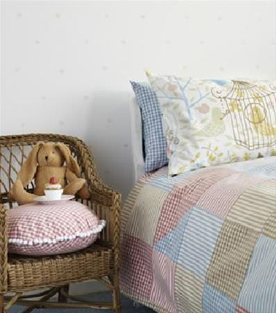 Sandberg -  Engla And Elliot Fabric Collection - Wicker armchair, bed with multicoloured gingham patchwork bedspread, with a round gingham cushion, and blue checked and patterned pillows