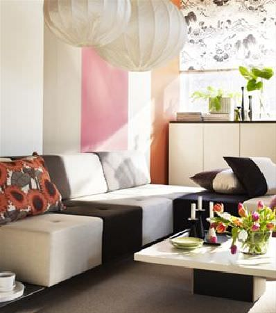 Sandberg -  Engla And Elliot Fabric Collection - Corner sofa made up of black and white blocks, with a low, square black and white coffee table, three different cushions, paper light shades