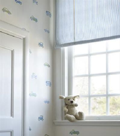 Sandberg -  Engla And Elliot Fabric Collection - Blue and green car print wallpaper, with a small cream teddy and thinly striped blue and white roll-up blinds