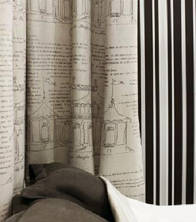 Sandberg -  Nora Fabric Collection - Cream fabric covered in handwritten text and sketches of bandstands, beside striped wallpaper, brown-grey cushions, and plain cream fabric