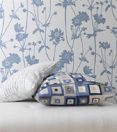 Sandberg -  Ofelia Fabric Collection - Blue and white floral background with one cushion covered in blue, white and grey squares and one cushion in white with black text across it