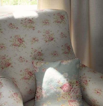 Sarah Hardaker -  Florence Fabric Collection - Light blue coloured padded armchair covered in a pink and green floral pattern, with a matching cushion which has a slightly larger print
