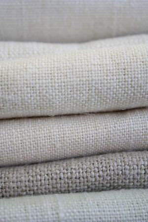 Sarah Hardaker -  Plain Vintage Linen Fabric Collection - A stack of five similar woven cream coloured fabrics
