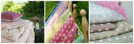 Sarah Hardaker -  Polka Dot Fabric Collection - A variety of colours of polka dot fabrics laid out in swatches, hanging from a line, and made into cushions with plain and floral fabrics