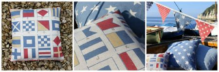 Sarah Hardaker -  Semaphore Fabric Collection - Semaphore flags printed in rows on white cushions, with a blue and white polka dot cushion and red, white and blue patterned bunting