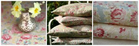 Sarah Hardaker -  Vintage Paisley Fabric Collection - Floral fabrics in a stack, made into a tower of four cushions, and as a tablecloth beneath a small, pewter coloured vase