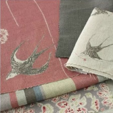 Sarah Hardaker -  Wiveton Fabric Collection - Modern red, white and dark grey fabrics from the Wiveton collection decorated with a matching pattern of swallows