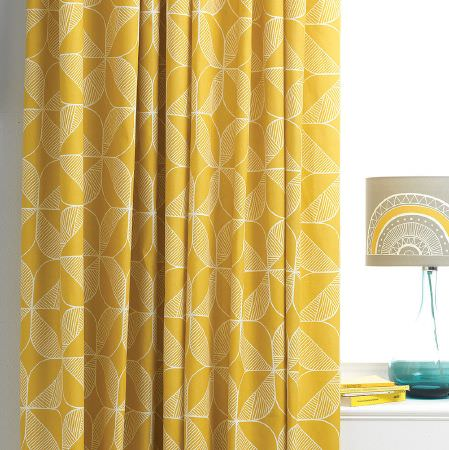 Sian Elin -  Sian Elin Fabric Collection - Curtain dyed in vibrant yellow shade decorated with a pattern of geometric-like flowers in white