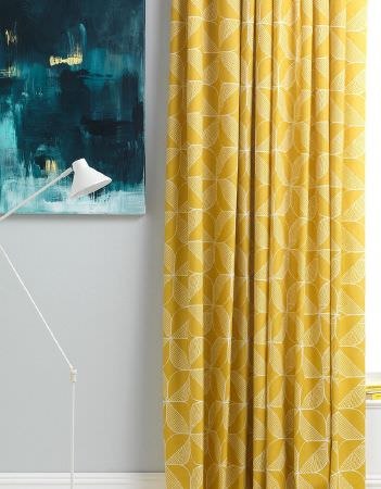 Sian Elin -  Sian Elin Fabric Collection - Very simple, white table lamp and vibrant yellow curtain decorated with an interesting white floral pattern