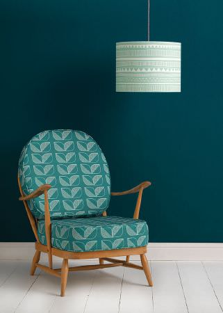 Sian Elin -  Sian Elin Fabric Collection - Mint green ceiling lamp decorated with white tribal pattern and teal chair with simple white decorative pattern