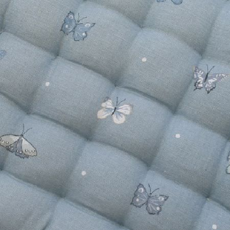 Sophie Allport -  Sophie Allport Fabric Collection - Quilted light blue fabric which has been printed with rows of tiny butterflies shaded in blue and white, as well as tiny white dots