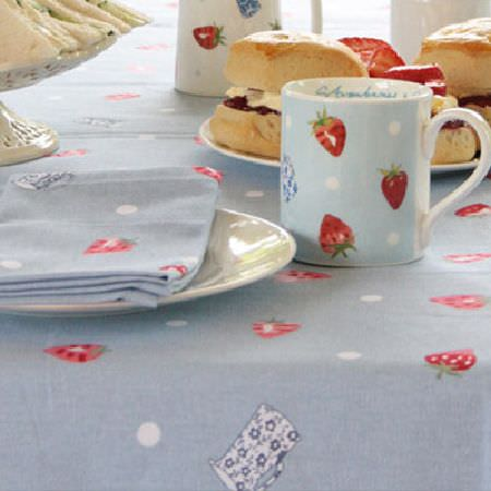 Sophie Allport -  Sophie Allport Fabric Collection - Strawberry print mugs, tablecloth and napkin in shades of blue, white and red,with two white plates and a cake stand