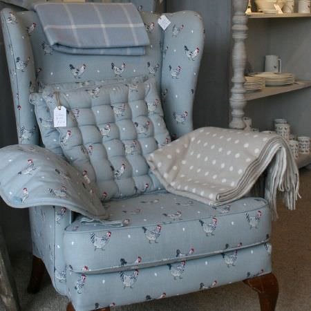 Sophie Allport -  Sophie Allport Fabric Collection - Grey, white and red chicken print armchair with matching quilted seat cushions, a blue and white checked blanket and a brown polka dot blanket