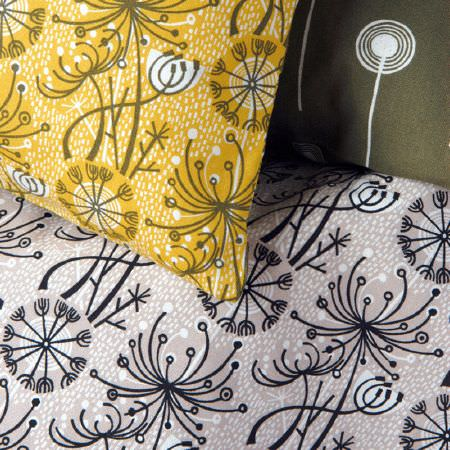 St Judes -  Angie Lewin Fabric Collection - Simple dandelion patterned cushion in mustard yellow, lilac fabric with a matching print, and an Army green and white cushion