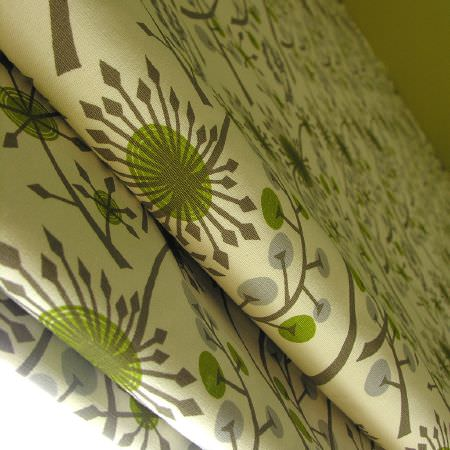 St Judes -  Angie Lewin Fabric Collection - Folds of a green, grey and cream patterned fabric blind