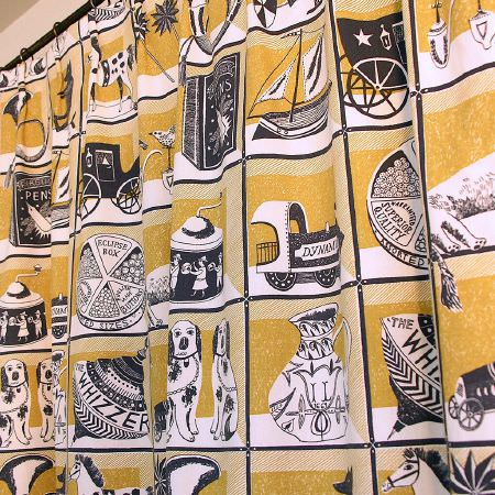 St Judes -  Emily Sutton Fabric Collection - Curtains covered in gold, white and black squares, each containing a toy or item of interest from Victorian times
