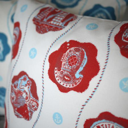 St Judes -  Jonny Hannah Fabric Collection - Nautical themed white, red and light blue cushions, with details of anchor, diving helmet and mermaid designs