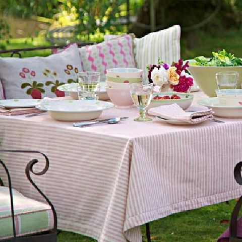 Susie Watson Designs -  Susie Watson Designs Fabric Collection - Colourful outdoor eating, pink and white striped tablecloth, striped and zigzag cushions in pink, white and green