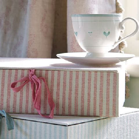 Susie Watson Designs -  Susie Watson Designs Fabric Collection - Neutral curtains with fringe. Candy-pink striped box with pink bow, pale blue srtiped box with blue bow..
