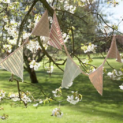 Susie Watson Designs -  Susie Watson Designs Fabric Collection - Bunting formed from striped pastel fabric of pink, blue and eau de nil.