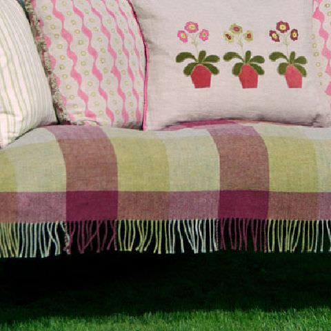 Susie Watson Designs -  Susie Watson Designs Fabric Collection - Throw with squares in shades of red and green with fringe. Cushions with pale green stripes, pink and floral pattern with edging.