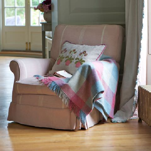 Susie Watson Designs -  Susie Watson Designs Fabric Collection - Fringed curtain in eau de nil.  Armchair in white striped pink fabric, pink edged floral cushion and pink and blue fringed throw.