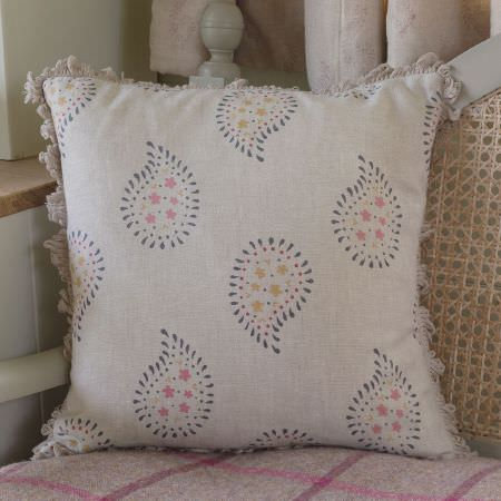 Susie Watson Designs -  Susie Watson Designs Fabric Collection - A simple paisley design in pink, grey and green, on a white cushion with fringing, on a chair with a pink checked throw