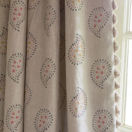 Susie Watson Designs -  Susie Watson Designs Fabric Collection - Fringing running down the edge of beige curtains featuring a simple floral paisley pattern in grey, pink and yellow-green