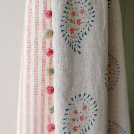 Susie Watson Designs -  Susie Watson Designs Fabric Collection - Pink and grey pompoms edging curtains with pink and white stripes on one side, and a simple floral paisley design on the other