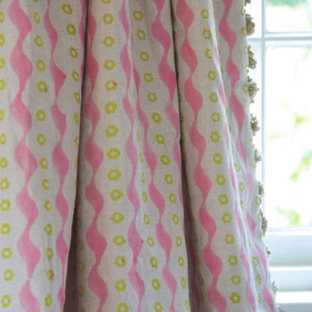 Susie Watson Designs -  Susie Watson Designs Fabric Collection - Pink wavy lines and green dots running down pale grey-white curtains made with light grey fringing down the edge
