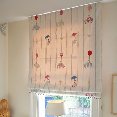 Susie Watson Designs -  Susie Watson Designs Fabric Collection - Elephants, umbrellas, balloons and stripes on a blue, red and cream blind, with striped bunting and a cream lampshade