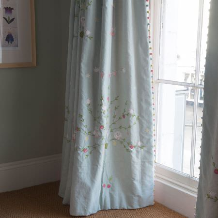 Susie Watson Designs -  Susie Watson Designs Fabric Collection - Large but subtle, pale coloured trees, flowers and birds patterning light duck egg blue curtains with small pompom edges