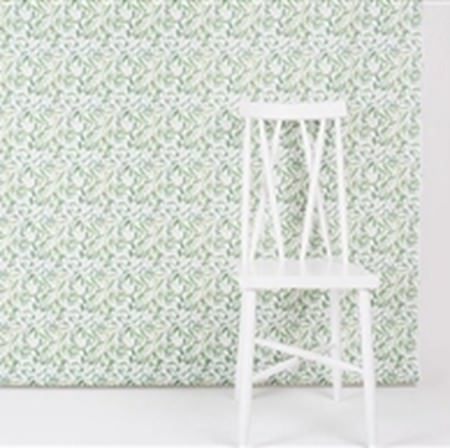 Swedish Fabric Company -  Boras Cotton Collection - A small green and white pattern covering a wall behind a simple white painted wood chair