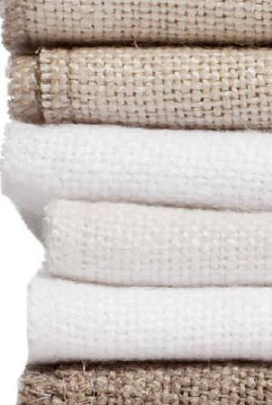 Swedish Fabric Company -  Himla Fabric Collection - Pile of woven cream and straw coloured fabrics