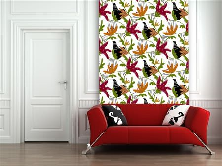 Swedish Fabric Company -  Kinnamark Fabric Collection - Wall hanging with white background and red, geen and orange abstract flowers, a red fabric sofa with black and white cushions.