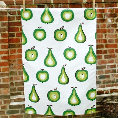 Swedish Fabric Company -  Klippan Fabric Collection - White tablecloth depicting green apples and pears in naif style.