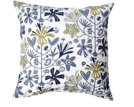 Swedish Fabric Company -  Klippan Fabric Collection - White cushion with pale blue and green flowers in freestyle.