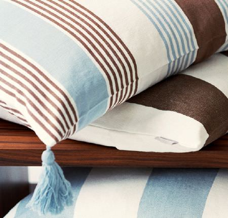 Swedish Fabric Company -  Linum Fabric Collection - Cushions with cream, brown and light blue stripes, one with a pale blue tassel