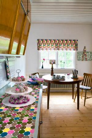 Swedish Fabric Company -  Mairo Fabric Collection - Muti-coloured Roman Blind and matching tablecloth.