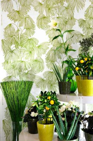 Swedish Fabric Company -  Mairo Fabric Collection - White curtain with large pale green frond-like leaf pattern.