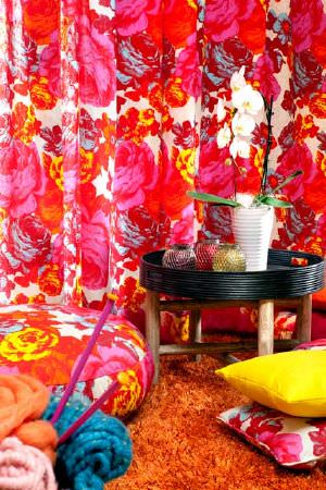 Swedish Fabric Company -  Mairo Fabric Collection - Bright pink large patterned floral curtains with splashes of white and yellow with large matching floor cushions and brigth yellow cushion.