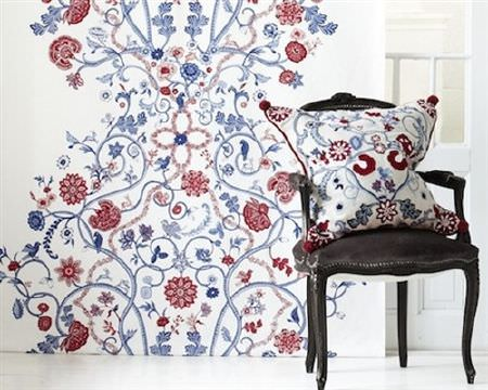 Swedish Fabric Company -  SVP Textil Fabric Collection - Black wood and fabric armchair, with a white, red and blue patterned cushion in front of a matching background
