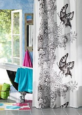 Swedish Fabric Company -  Vallila Fabric Collection - White curtains with dramatic black and grey butterflies and foliage. Plain turquoise, pink and green fabrics.