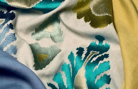 Threads -  Fascination Embroideries Fabric Collection - Elegant fabrics in white, blue and yellow decorated with colourful and shiny abstract patterns