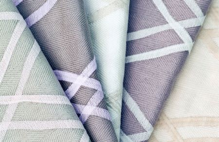 Threads -  Fascination Embroideries Fabric Collection - Fabrics dyed in light shades of mint green and purple decorated with the same modern geometric design in white